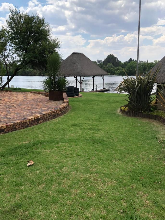Manicured garden and view of Jetty