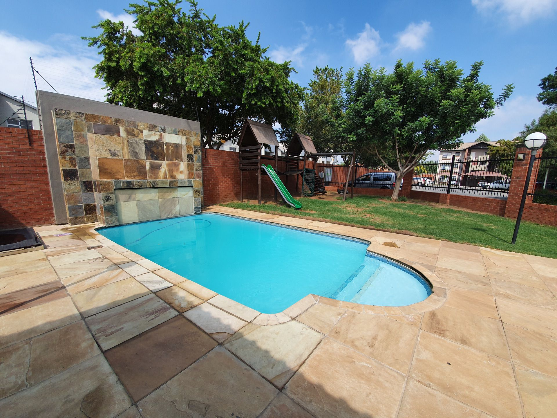 Lovely pool area and spacious garden with play area for kids
