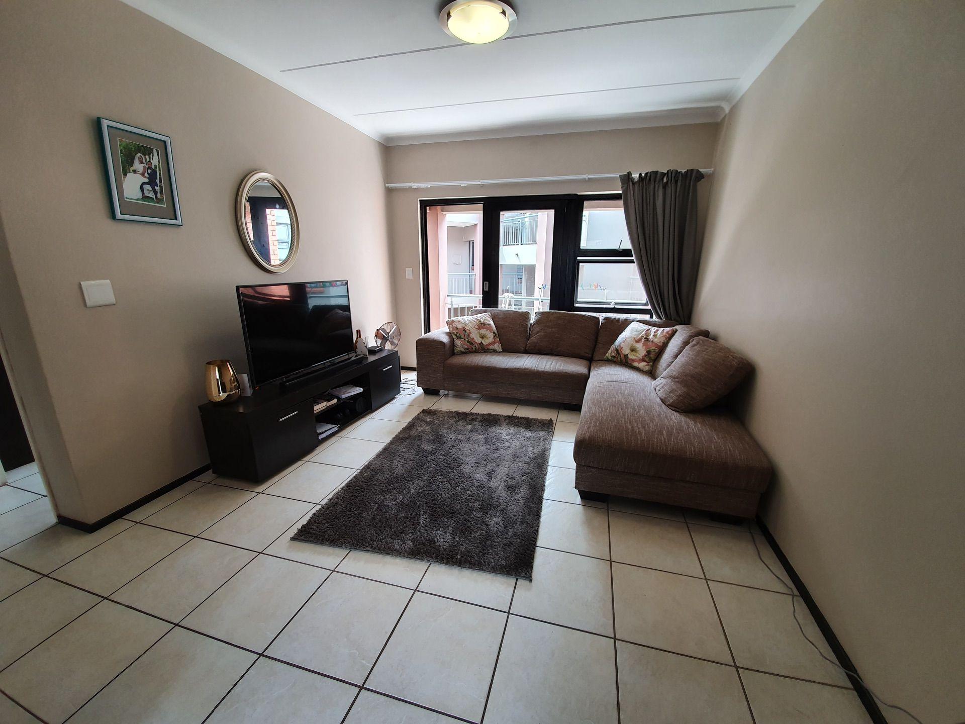 Lounge area with sliding door. Leading onto the balcony