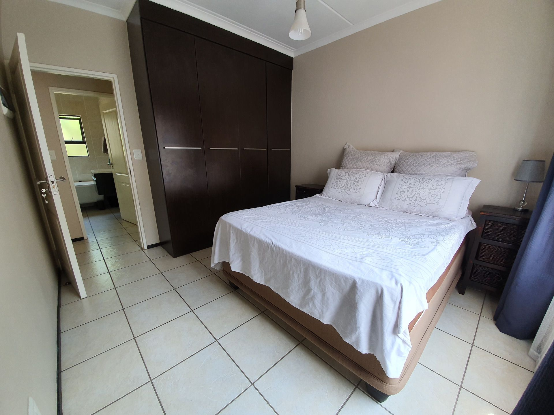 Master bedroom with built-in cupboards