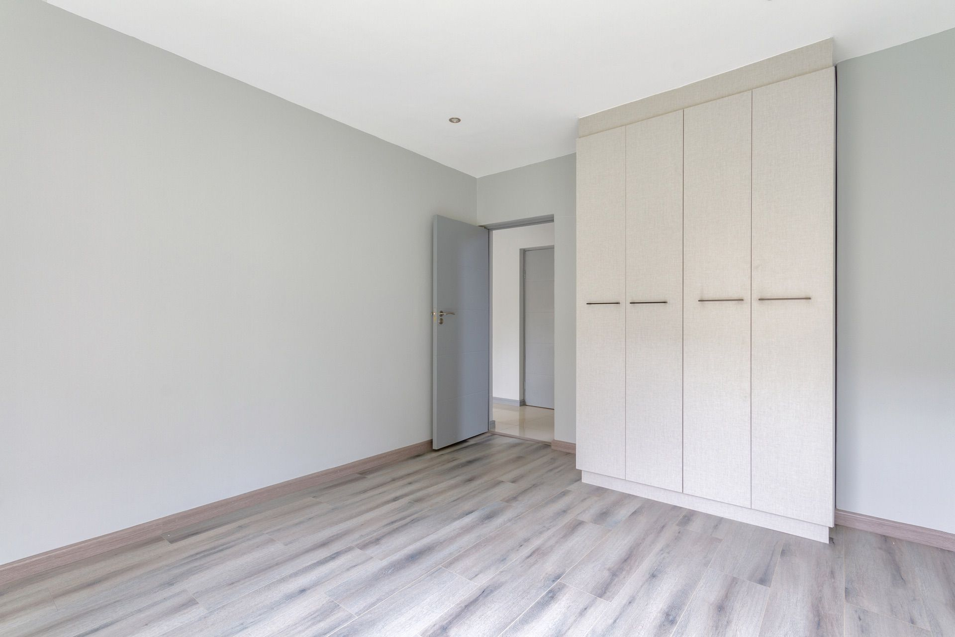 1st guest bedroom with built in cupboards