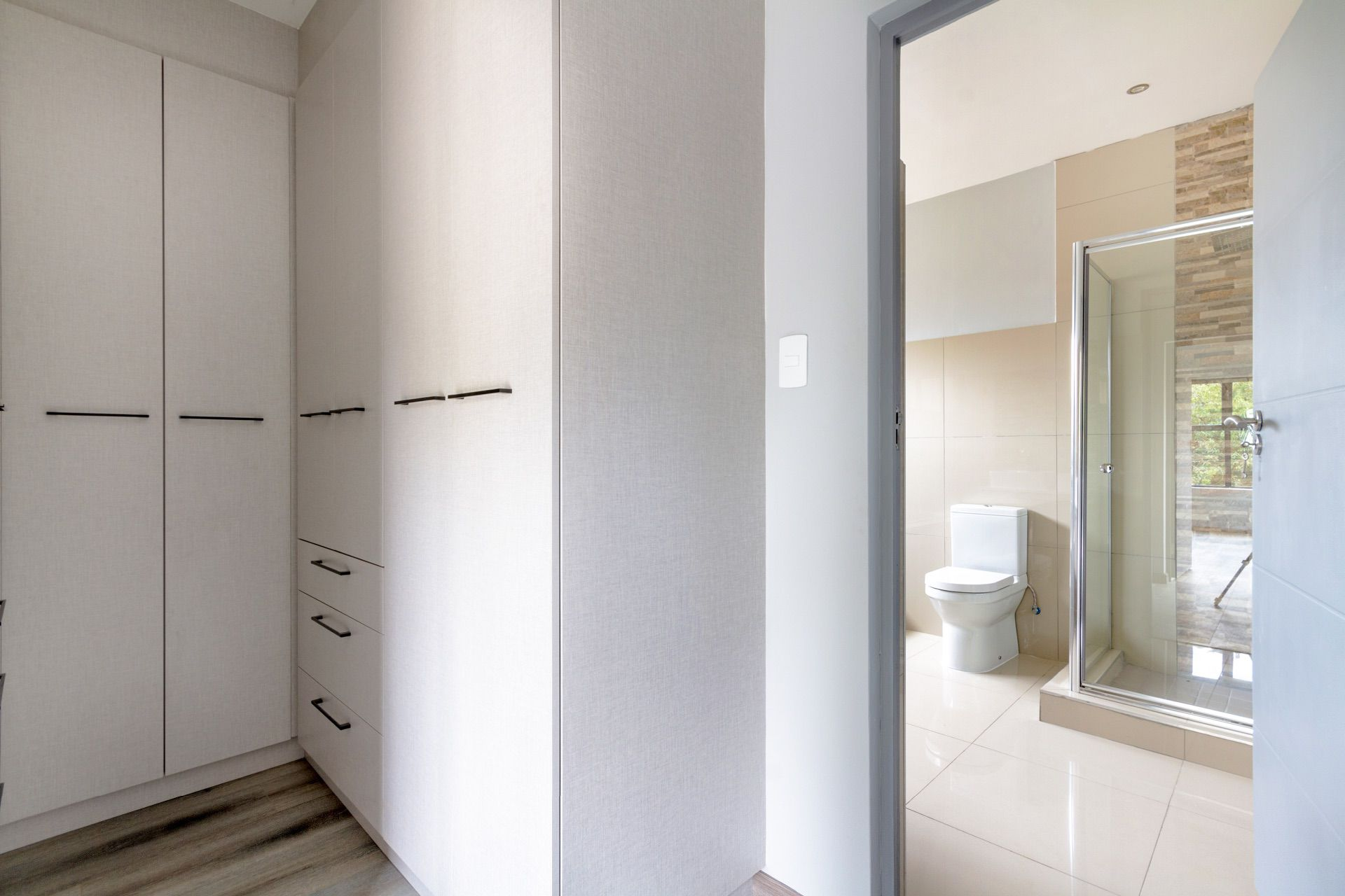 Master walk-in closet and en-suite bathroom