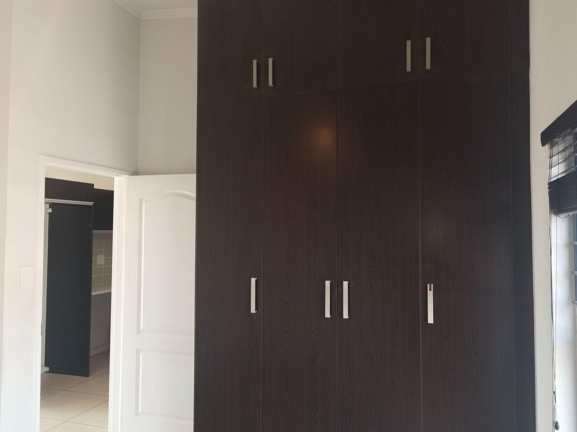Bedroom with extra cupboards.jpg